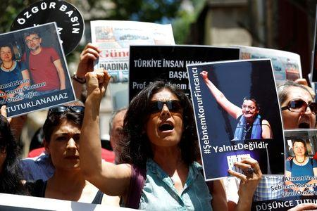 Turkish court frees two press-freedom campaigners, third still in jail