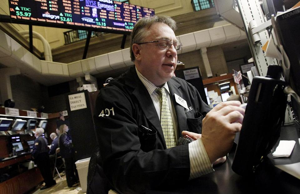 Trader Michael Iervoline works on the floor of the New York Stock Exchange Friday, Feb. 3, 2012. U.S. stocks are opening sharply higher after the unemployment rate dropped to the lowest in two years. (AP Photo/Richard Drew)