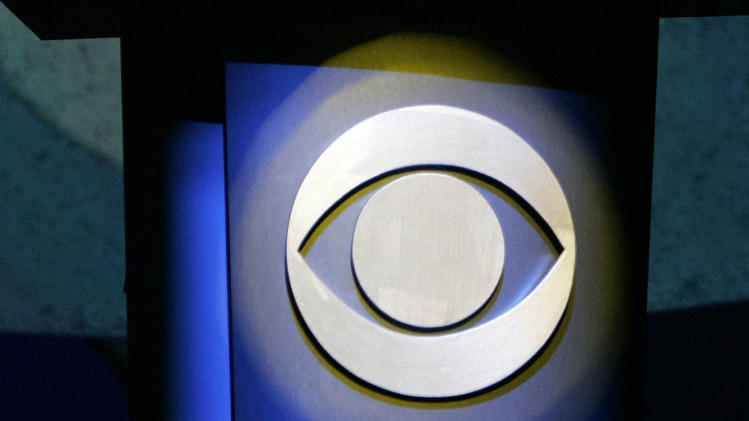 FILE - In this Jan. 9, 2007 file photo, a CBS Corp. logo is silhouetted in Las Vegas. CBS reports its quarterly earnings on Wednesday, Feb. 14, 2014. (AP Photo/Jae C. Hong, File)
