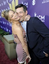 LeAnn Rimes and Eddie Cibrian get extra close on the red carpet of the 47th Annual Academy of Country Music Awards held at the MGM Grand Garden Arena in Las Vegas, Nevada on April 1, 2012 -- Getty Images