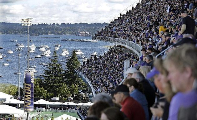 Husky Stadium in Seattle. Boats are moored in Lake Washinton just outside the stadium. (AP Photo/Elaine Thompson)