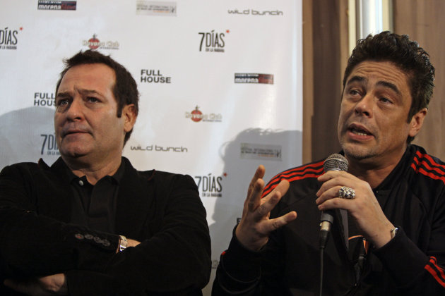 "Puerto Rico's actor Benicio del Toro, right, speaks next to Cuba's actor Jorge Perugorria during the presentation of Del Toro's first film as director: ""Seven Days"" at the National hotel in Havana, Cuba, Friday, Dec. 9, 2011. (AP Photo/Franklin Reyes)"