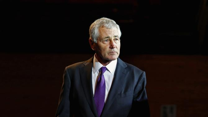 Hagel walks during a farewell ceremony in Virginia