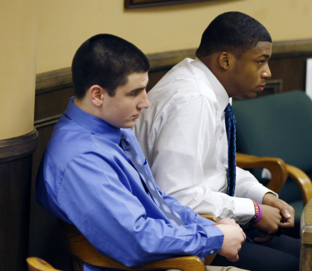 Trent Mays, 17, left, and co-defendant 16-year-old Ma'lik Richmond sit in court before the start of the third day of their trial on rape charges in juvenile court on Friday, March 15, 2013 in Steubenv