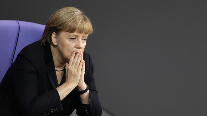 German Chancellor Angela Merkel attends a meeting of the German federal parliament, Bundestag, in Berlin, Germany, Thursday, Nov. 29, 2012. (AP Photo/Michael Sohn)