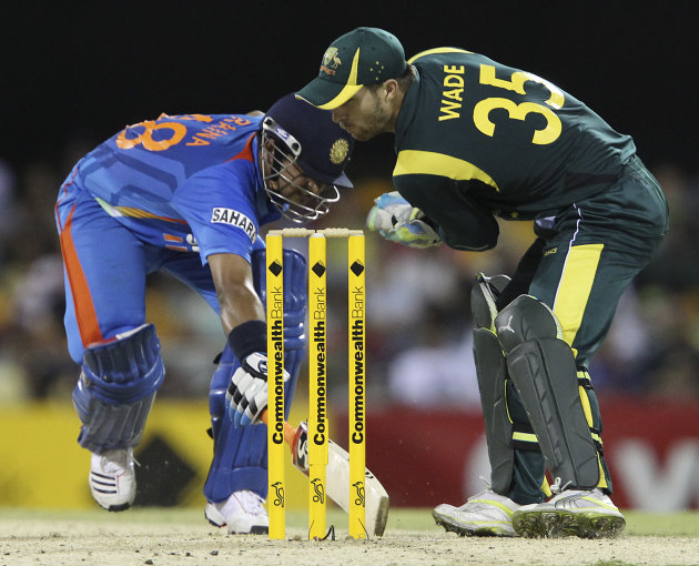 India's Suresh Raina, left, clashes with Australia's Matthew Wade, right, during the One Day International cricket match between Australia and India in Brisbane, Australia, Sunday, Feb. 19, 2012. (AP