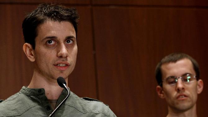 Freed American Josh Fattal, left, speaks to reporters as fellow former captive Shane Bauer listens Sunday, Sept. 25, 2011, in New York. The two were released after being held for espionage in an Iranian jail for almost two years. (AP Photo/Craig Ruttle)
