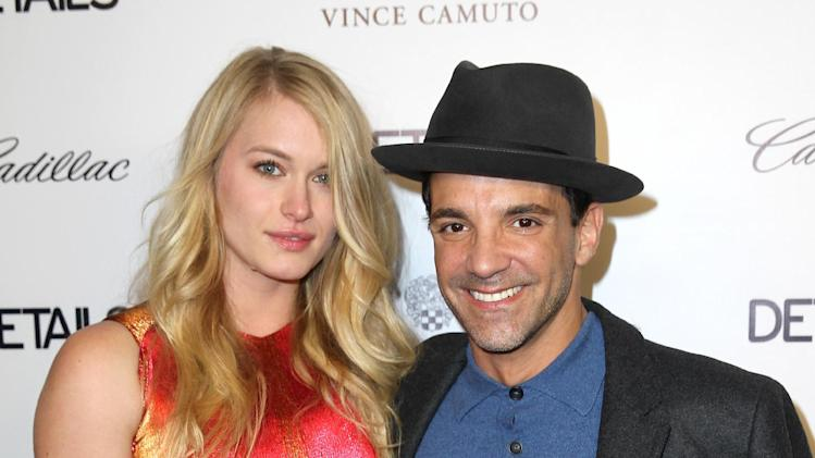 Leven Rambin, left, and George Kotsiopoulos arrive at the DETAILS Hollywood Mavericks Party hosted by Dan Peres at Soho House on Thursday, Dec. 5, 2013, in West Hollywood, Calif. (Photo by Matt Sayles/Invision for DETAILS Magazine/AP Images)