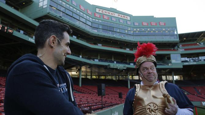 "Actors Coen and Melendy wait to take the stage to rehearse a scene before the Commonwealth Shakespeare Company's production ""Shakespeare at Fenway"" at Fenway Park in Boston"