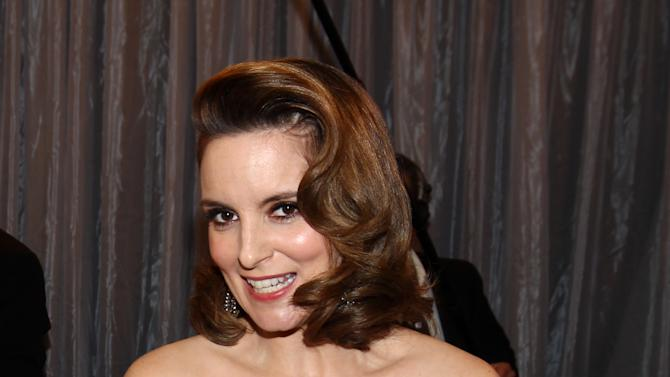 """Tina Fey is seen backstage with the award for outstanding female actor in a comedy series for """"30 Rock"""" at the 19th Annual Screen Actors Guild Awards at the Shrine Auditorium in Los Angeles on Sunday Jan. 27, 2013. (Photo by Matt Sayles/Invision/AP)"""