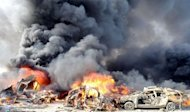 A picture released by the Syrian Arab News Agency (SANA) shows smoke rising from burning cars at the site of twin blasts in Damascus on May 10, 2012. Suicide attackers detonated massive bombs in Damascus during the morning rush hour on Thursday, killing at least 55 people and wounding nearly 400 in the deadliest bombings of Syria's 14-month uprising. (AFP Photo/)