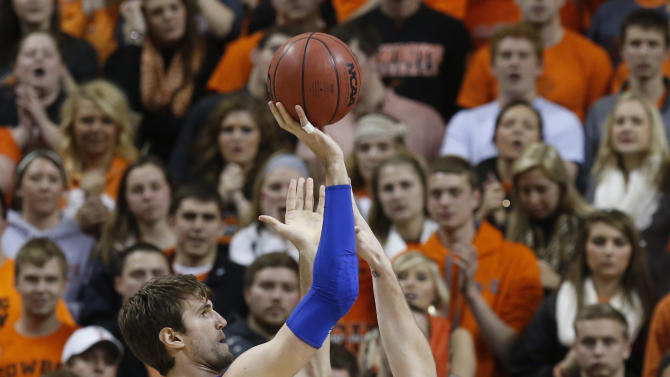 Kansas center Jeff Withey (5) shoots over Oklahoma State forward Philip Jurick (44) during the first half of an NCAA college basketball game in Stillwater, Okla., Wednesday, Feb. 20, 2013. (AP Photo/Sue Ogrocki)