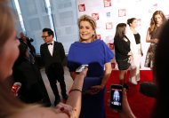 French actress Catherine Deneuve is interviewed as she arrives for the Film Society of Lincoln Center&#39;s 39th annual Chaplin Award Gala at Alice Tully Hall, Monday, April 2, 2012 in New York. (AP Photo/Jason DeCrow)