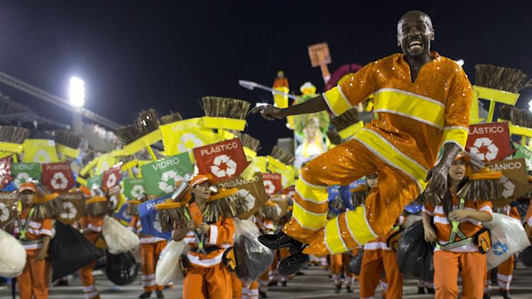 Brazilian garbage collector and dancer Renato Sorriso from the Academicos do Grande Rio samba school parades during carnival celebrations at the Sambadrome in Rio de Janeiro, Brazil, Tuesday, Feb. 12, 2013. (AP Photo/Felipe Dana)