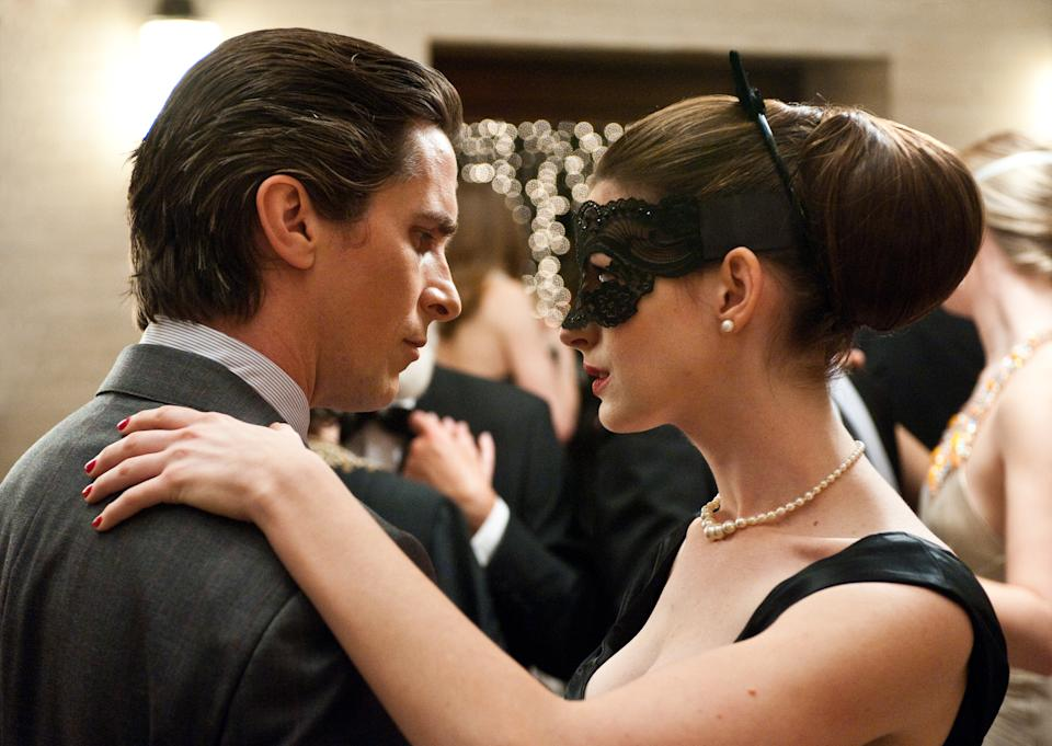 "This undated film image released by Warner Bros. Pictures shows Christian Bale as Bruce Wayne, left, and Anne Hathaway as Selina Kyle in a scene from the action thriller ""The Dark Knight Rises."" (AP Photo/Warner Bros. Pictures, Ron Phillips)"