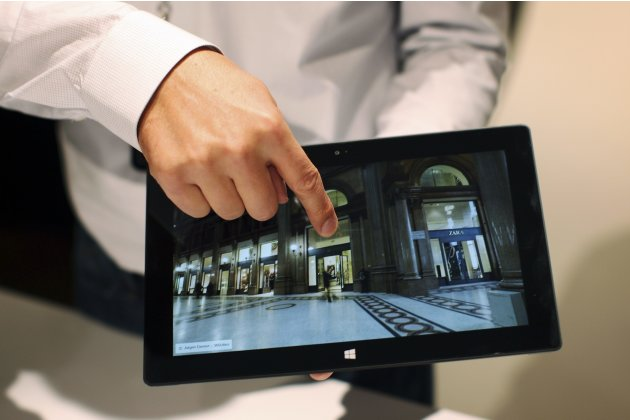 A Microsoft representative scrolls the screen of the new Surface tablet computer as it is unveiled in Los Angeles