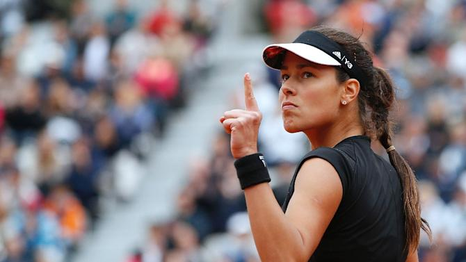 Serbia's Ana Ivanovic celebrates after winning a point against Russia's Ekaterina Makarova during the women's fourth round of the Roland Garros 2015 French Tennis Open in Paris on May 31, 2015