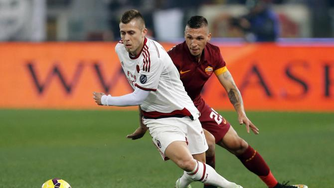 AS Roma's Holebas challenges AC Milan's Menez during their Italian Serie A soccer match in Rome