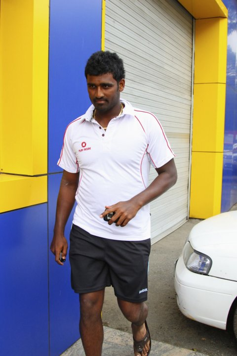 Sri Lanka's Perera arrives at Sri Lanka cricket board headquarters in Colombo
