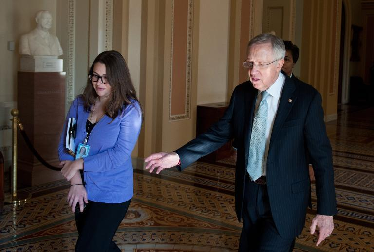 US Senate Majority Leader Harry Reid (R) walks through a corridor to his office on October 5, 2013 at the US Capitol in Washington, DC