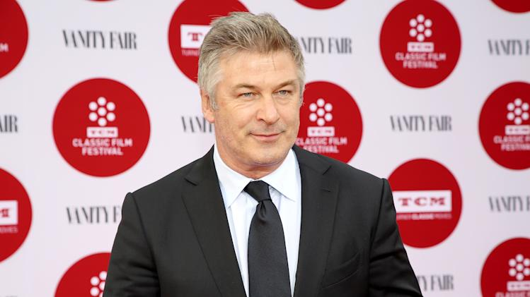FILE - In this April 10, 2014 file photo, Alec Baldwin arrives 2014 TCM Classic Film Festival's Opening Night Gala at the TCL Chinese Theatre in Los Angeles. Officials at the Adams Memorial Library in Central Falls, R.I., said Baldwin will headline a fundraiser for the struggling public library June 7, at Fete in Providence, R.I. (Photo by Annie I. Bang /Invision/AP, File)