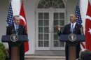 U.S. President Obama reacts to falling rain during joint news conference with Turkish Prime Minister Erdogan at the White House in Washington