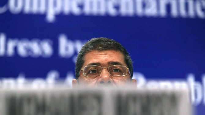 Egyptian President Mohammed Morsi attends a business meeting in New Delhi, India , Wednesday, March 20, 2013. Morsi and Indian Prime Minister Manmohan Singh held talks Tuesday aimed at strengthening ties and boosting trade and investment between their countries. (AP Photo/ Saurabh Das)