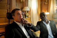 "In this film image released by The Weinstein Company, Francois Cluzet, left, and Omar Sy are shown in a scene from ""The Intouchables."" (AP Photo/The Weinstein Company, Thierry Valletoux)"