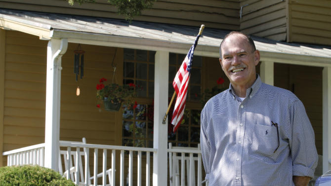 This photo taken Oct. 10, 2012 shows Virginia voter Harry Donahue outside his farmhouse, built in the 1700's , in Farmville, Va. Donahue, a 68-year-old retired chemical worker from Philadelphia's New Jersey suburbs, moved to Virginia in 2001 and brought with him an independent streak and a voting pattern that ranges from Ronald Reagan to Ross Perot. He plans to back Obama this year after supporting John McCain in 2008.  (AP Photo/Steve Helber)