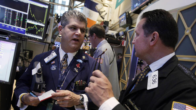 Traders John Panin, left, and Edward Curran confer on the floor of the New York Stock Exchange Friday, June 22, 2012. Stocks are rising a day after suffering their second-worst loss this year. (AP Photo/Richard Drew)
