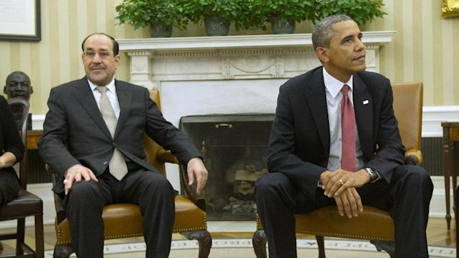 President Barack Obama and Iraqi Prime Minister Nouri al-Maliki stay in their seats, Friday, Nov. 1, 2013, following a meeting in the Oval Office of the White House in Washington. The prime minister arrived at the White House Friday to personally appeal to President Barack Obama for more U.S. assistance in beating back the bloody insurgency consuming his country. (AP Photo/Pablo Martinez Monsivais)