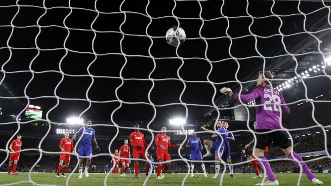 Chelsea's Ivanovic scores past Liverpool's Mignolet during their English League Cup semi-final second leg soccer match in London