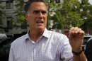 Republican presidential candidate and former Massachusetts Governor Mitt Romney talks to reporters after a brief meeting with a group of veterans in Concord