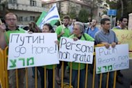 <p>Activists from the left wing Israeli party Meretz, call for visiting Russian President Vladimir Putin to take action in stopping violence in neighboring Syria as they protest in front of Israeli President Shimon Peres's home in Jerusalem, on June 25, 2012. AFP PHOTO/AHMAD GHARABLI</p>