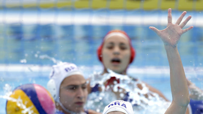 Italy's Federica Radicchi, front, and Brazil's Lucianne Barroncas, center rear, challenge for the ball during a women's water polo preliminary round group C match between Brazil and Italy at the Swimming World Championships in Kazan, Russia, Thursday, July 30, 2015. Italy defeated Brazil by 15-6. (AP Photo/Michael Sohn)