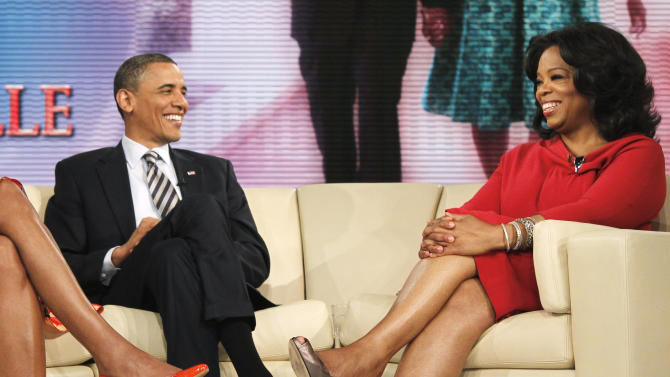 President Barack Obama and first lady Michelle Obama are pictured with Oprah Winfrey during a taping of The Oprah Winfrey Show at Harpo Studios in Chicago, Wednesday, April 27, 2011. (AP Photo/Charles Dharapak)