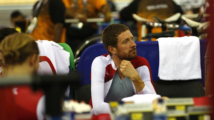 England's 4000 meter team pursuit member Bradley Wiggins waits for his event in the Chris Hoy velodrome at the Commonwealth Games Glasgow 2014, in Glasgow, Scotland Thursday, July, 24, 2014. (AP Photo/Alastair Grant)
