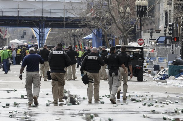 Public safety officials evacuate the scene after explosions near the finish line of the 117th Boston Marathon in Massachusetts
