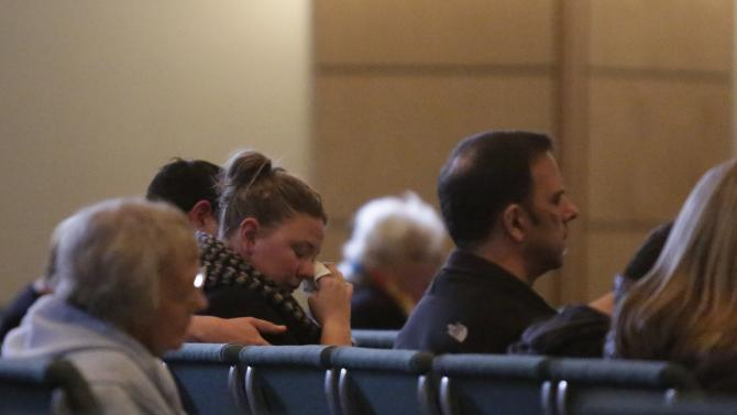 Community members attend a vigil at Mountain View Presbyterian Church the day after a shooting at Marysville-Pilchuck High School in Marysville, Washington