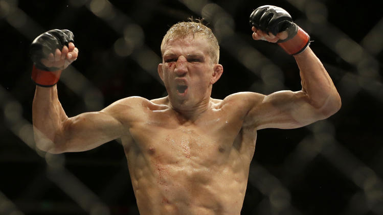 T.J. Dillashaw celebrates after defeating Joe Soto in a bantamweight championship mixed martial arts bout at UFC 177 in Sacramento, Calif., Saturday, Aug. 30, 2014. Dillashaw won by technical knockout in the fifth round to retain his championship. (AP Photo/Jeff Chiu)