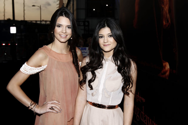 Kendall, left, and Kylie Jenner arrive to the world premiere of &quot;The Twilight Saga: Breaking Dawn - Part 1&quot; on Monday, Nov. 14, 2011, in Los Angeles. (AP Photo/Matt Sayles)