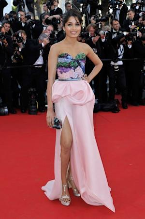 Freida Pinto shows off a pink gown at the opening ceremony and 'Moonrise Kingdom' premiere during the 65th Annual Cannes Film Festival at Palais des Festivals in Cannes, France on May 16, 2012   -- Getty Images