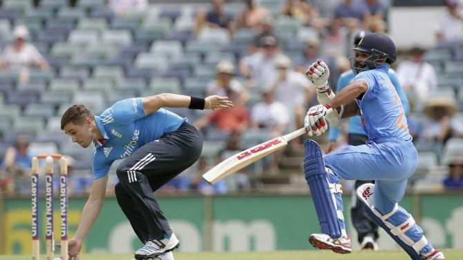 England's Woakes attempts unsuccessfully to run out India's Dhawan during their ODI tri-series cricket match at the WACA ground in Perth