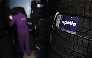 An employee works inside the warehouse at the Apollo Super Zone showroom in Mumbai
