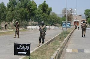 Pakistani soldiers stand guard near a public school …