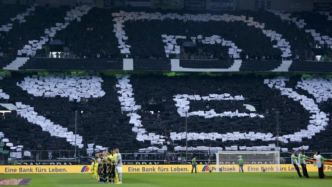Supporters of Borussia Moenchengladbach form club logo as team lines-up with Villareal players prior to Europa League soccer match in Muenchengladbach