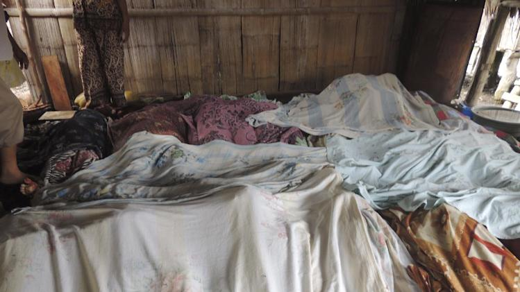 Bodies of victims in the brazen attack by about 40 to 50 Abu Sayyaf militants are covered in blankets at a makeshift morgue in Talipao township in Jolo in southern Philippines Tuesday, July 29, 2014. A 3-year-old boy and his father died from wounds suffered in the attack by Abu Sayyaf extremists on Filipinos celebrating the end of Ramadan, raising the toll Tuesday to 23 dead, officials said. Some 50 villagers aboard two passenger vehicles were ambushed by Abu Sayyaf militants Monday as they traveled on a southern road to visit relatives during the holiday ending the Muslim holy month. (AP Photo)