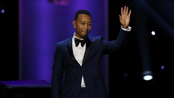 President's Award recipient John Legend waves after his performance at the 47th NAACP Image Awards in Pasadena