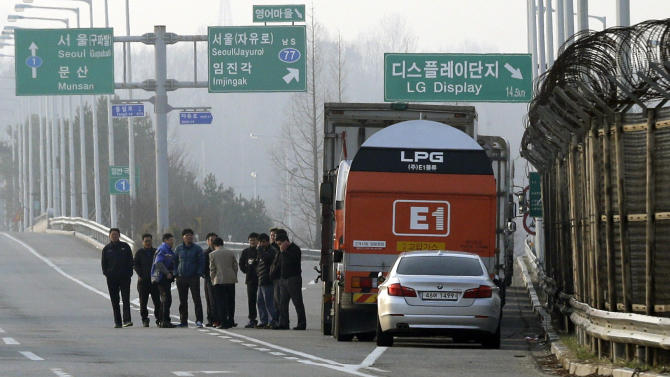 South Korean truck drivers gather as they wait for a chance to enter the customs, immigration and quarantine office at Unification Bridge near the border village of Panmunjom, which has separated the two Koreas since the Korean War, in Paju, north of Seoul, South Korea, Monday, April 8, 2013. A top South Korean national security official said Sunday that North Korea may be setting the stage for a missile test or another provocative act with its warning that it soon will be unable to guarantee diplomats' safety in Pyongyang. But he added that the North's clearest objective is to extract concessions from Washington and Seoul. (AP Photo/Lee Jin-man)