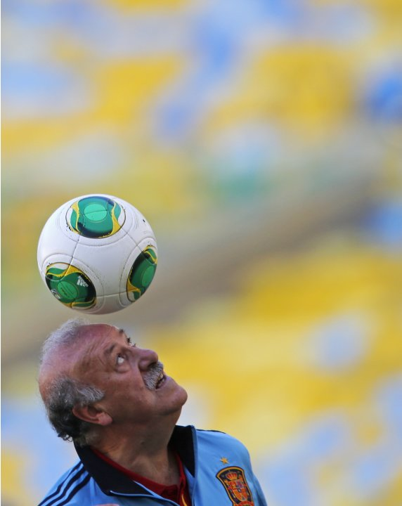 Spain's national soccer team coach Del Bosque heads a ball during a training session ahead of Confederations Cup soccer match in Rio de Janeiro